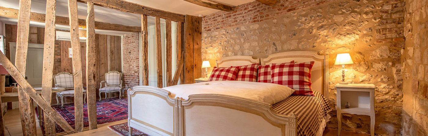 Des chambres et des suites chaleureuses et quip es for Chambre hote die